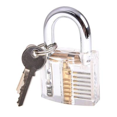 Průhledný visací zámek s nástroji pro otevření